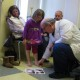 Alice Snyder, 6, and her parents, Ryan and Mary Snyder, meet with Dr. John Herzenberg at Sinai Hospital in Baltimore (Photo by Jenny Gold/KHN).